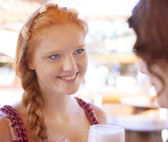 Redhead German Woman Wearing Traditional Dirndl Enjoying Oktoberfest