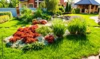 """Beautiful backyard landscape design. View of colorful ..."