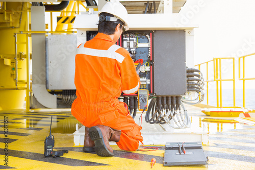 Electrical and instrument worker inspect and checking voltage and current of electric system at