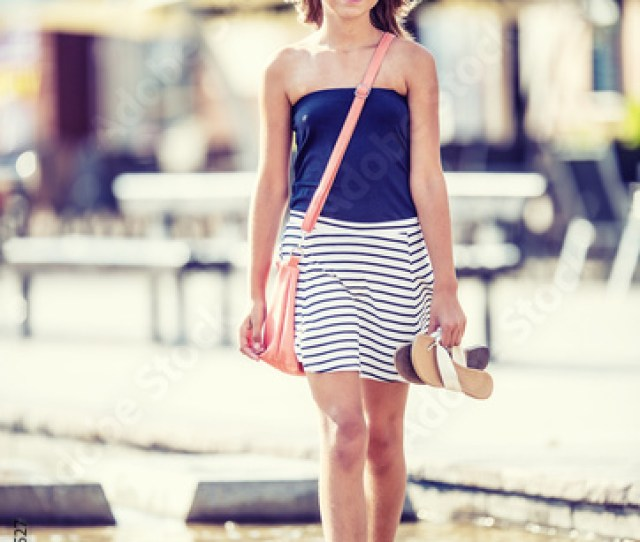 Cute Little Young Teen Girl Walking On The Fountain In Hot Summer Day