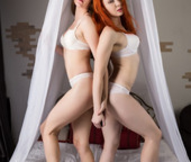 Two Beautiful Sexy Girls Hugging On A Bed In Hotel Room Brunette And Redhead Lesbians