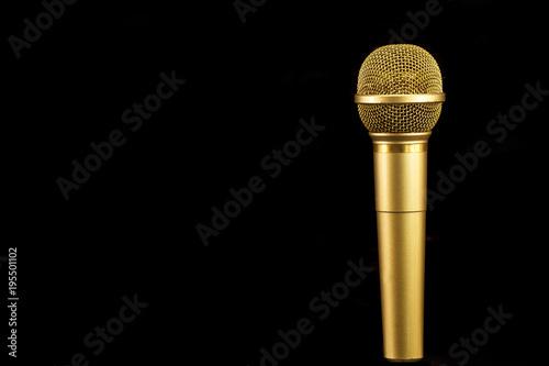 golden microphone on black