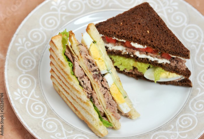 On The Plate Are Two Triangular Shaped Sandwiches One Sandwich Of