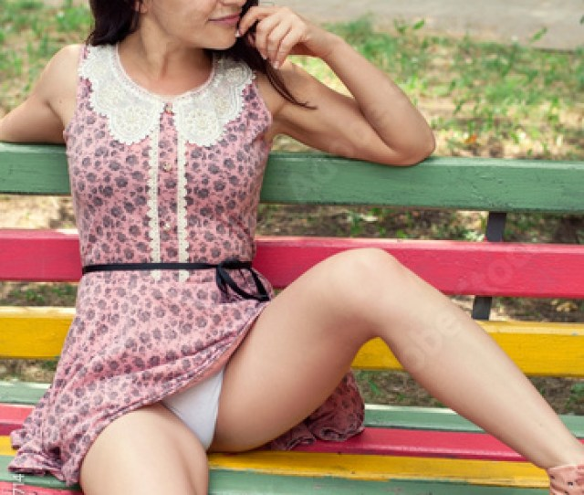 Sexy Woman Sits On A Bench Legs Spread Showing Panties