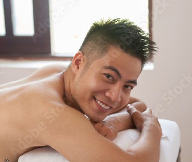 Portrait Of Handsome Young Asian Man Attending Massage Salon