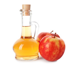 Glass jug of Apple Cider Vinegar and fresh apples