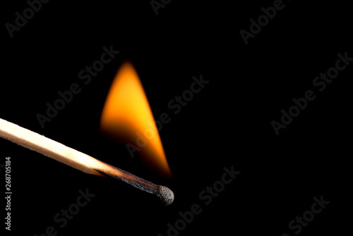 burning match stick in