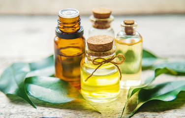 Tea tree essential oil in a small bottle.