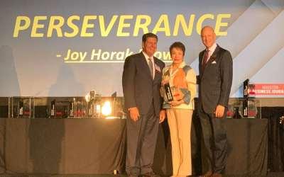 Joy Horak-Brown, president & CEO of New Hope Housing, receives honor