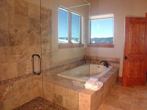 master-bath-with-steam-shower-and-tub-with-views-to-beaver-creek ...