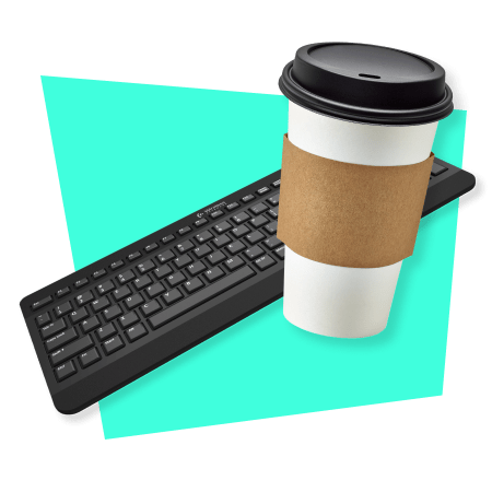 Photo of a computer keyboard with coffee