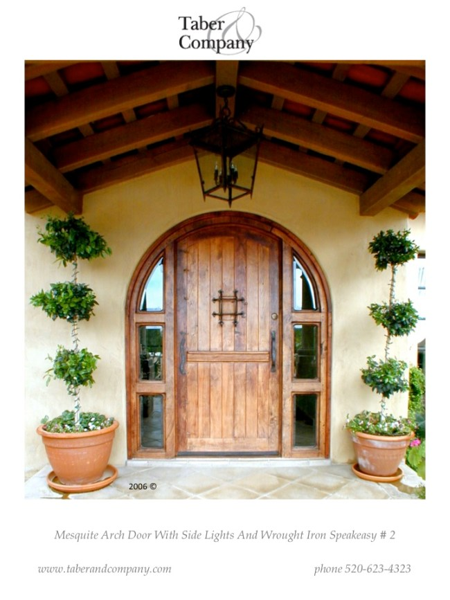 brow top door with hand forged wrought iron, brow top door with sidelights, front door with iron and glass, custom front doors scottsdale, wood front door with iron and glass, Mediterranean style front door, solid wood door with brow top, center door with glass, wood wrought iron front door with sidelights, eyebrow arch door glass, door with transom, arch main entry sidelights, arch style with sidelights, door side lites, solid wood craftsman door sidelight lites, spanish hacienda style door, santa barbara style door, rustic farmhouse door, rustic mediterranean door, modern wood door, custom wood doors scottsdale, salvaged wood front door, reclaimed wood, doors for luxury homes, Door transom, high end custom doors, spanish colonial doors, entry doors, front doors, mexican hacienda doors, doors with windows, spanish revival style doors, moroccan style homes doors, artistic doors, scottsdale art factory doors, santa fe style doors, southwestern doors, pueblo style doors, craftsman in wood doors, wood iron glass doors, massive doors, Craftsman style doors