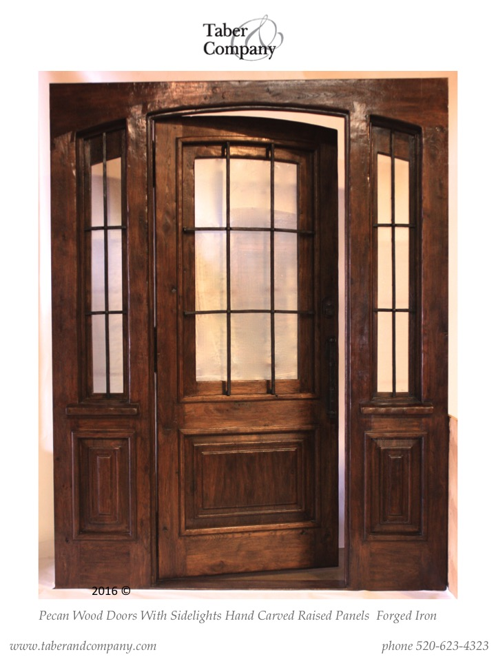 Mesquite Wood Arched Door With Side Lites And An Operable Window.