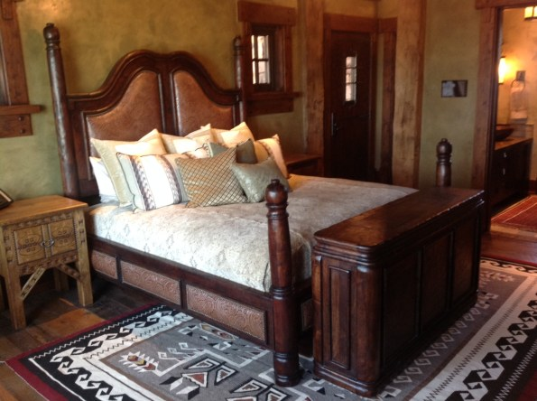 Four poster wood bed with leather luxury mountain home whitefish Montana