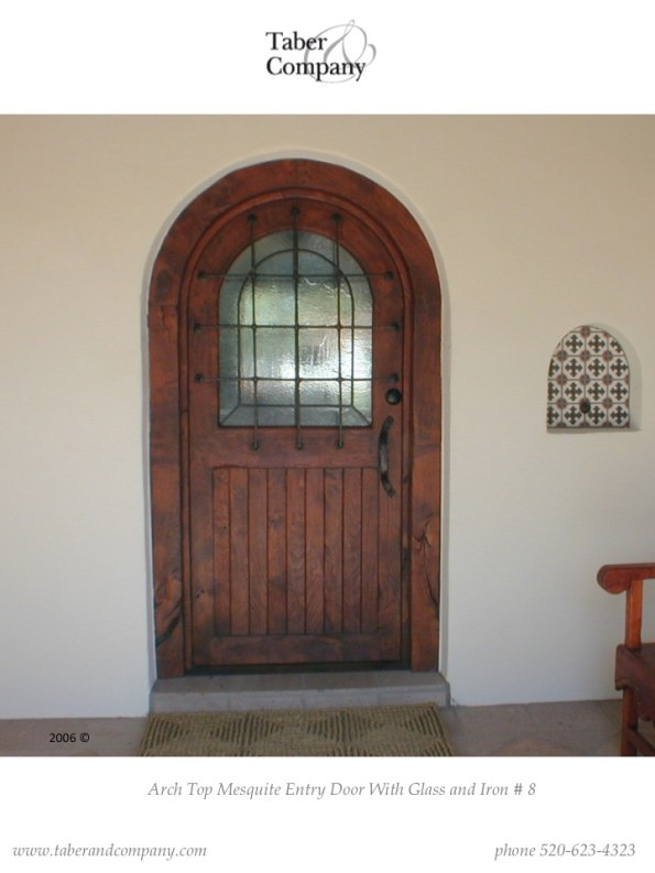 true arch wood door with glass and iron