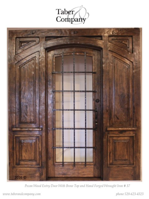 wood entry single door with side panels. wood and glass entry door with wood side panels.