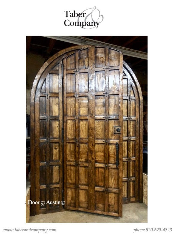 10' mediterranean style arched top door. One of a kind massive 10' wood entry door.