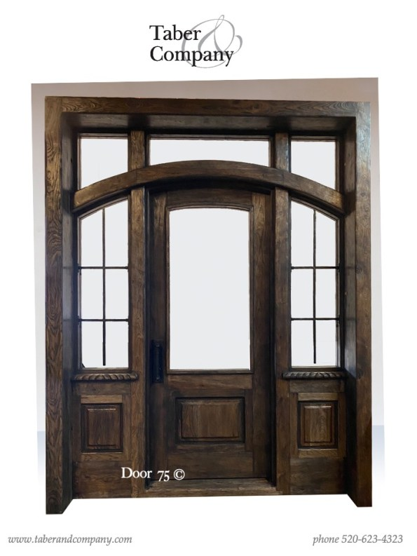 10' wood door with with sidelites transom for a luxury mountain home. Massive wooden entry door with sidelights transom mountain style home.