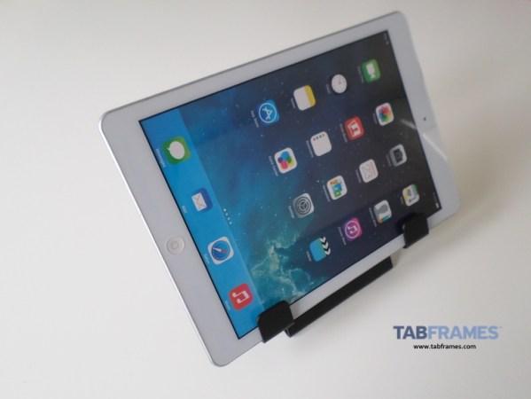 Showing universal tablet holder with tablet in landscape mode