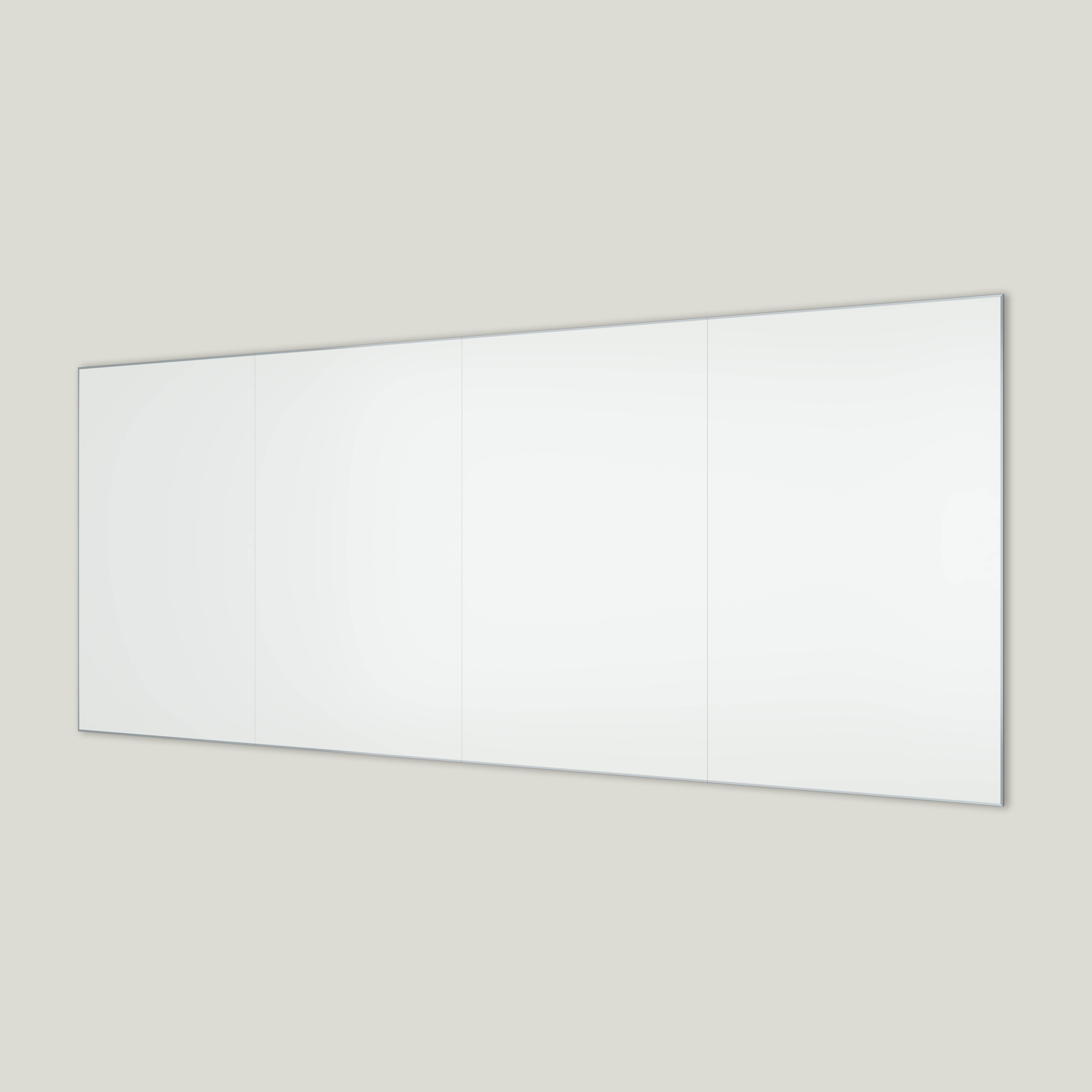Framed whiteboard mounted to wall