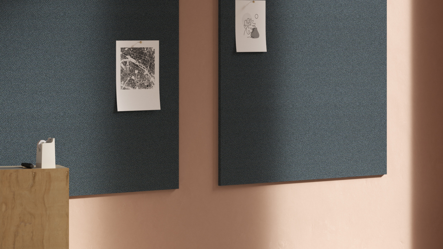 Two dark, fabric tackboards with papers pinned