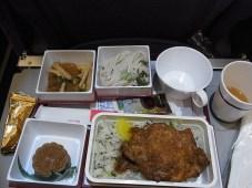 dans l'avion de retour, páigǔ, travers de porc sur riz sauté