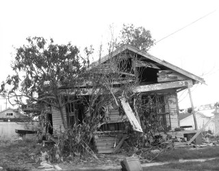 A black and white photo of a destroyed house