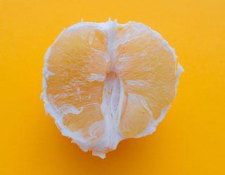 A sliced orange on an orange background