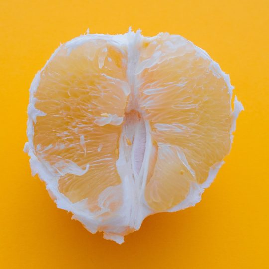 A sliced orange on an orange background