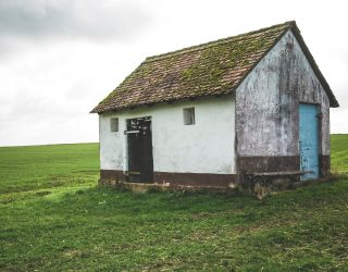 A small house in a field