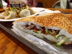 Sesame pancake sandwich with roasted duck