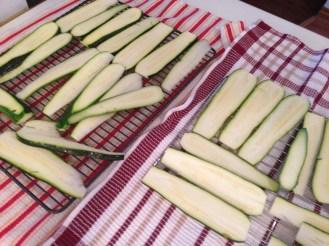 Lay zucchini on racks