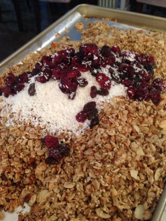 Mixing in the coconut and dried fruit post-bake