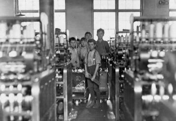 "Young doffers in Mollahan Mills in Newberry, South Carolina, on December 3, 1908. A doffer is someone who removes, or ""doffs"", bobbins or spindles that hold spun cotton or wool from a spinning frame, then replaces them with empty ones."