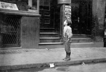 """Fire! Fire! I want to make the fire!"" An Italian boy on Salem Street on Saturday morning, offering to make fires for Jewish People on their Sabbath, in Boston, Massachusetts, in October of 1909."