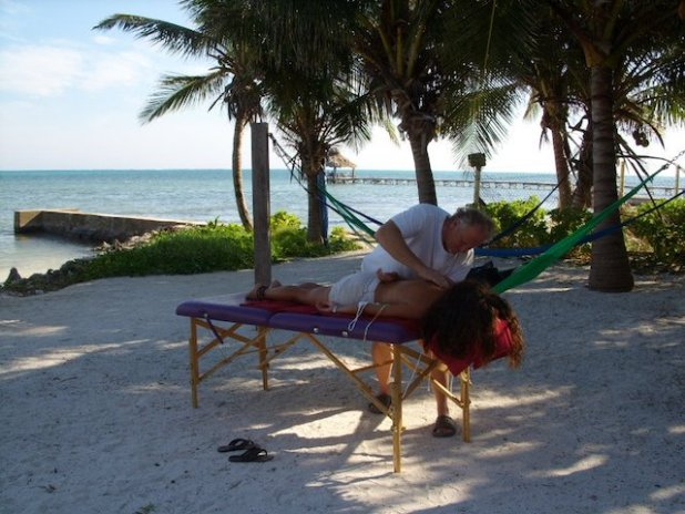 Zac giving a massage on the beach