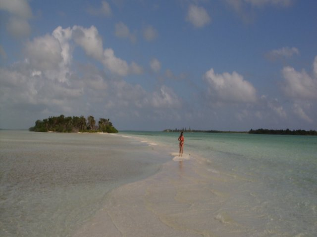 Carole walking along a sandbar
