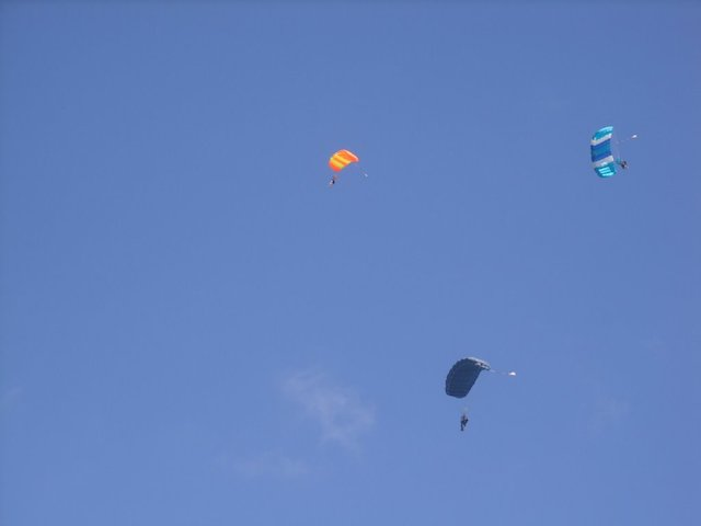 3 parachutes in the sky