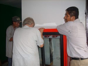 Steve helping level fridge