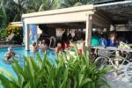 coco locos beach bar with swim up pool bar