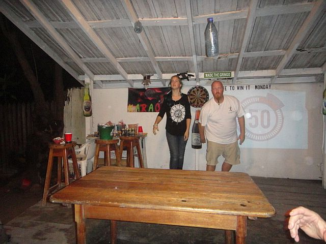 Kendall Beymer of Ecologic Divers and Tori Fearneyhouugh doing Minute to Win it Roadkill Bar Belize
