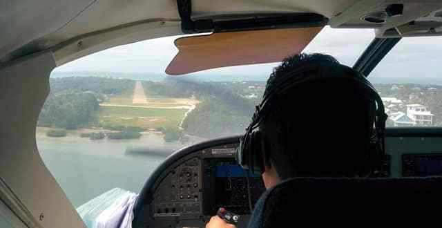 Cost of flying direct from BZE Airport versus cab to TZA Airport