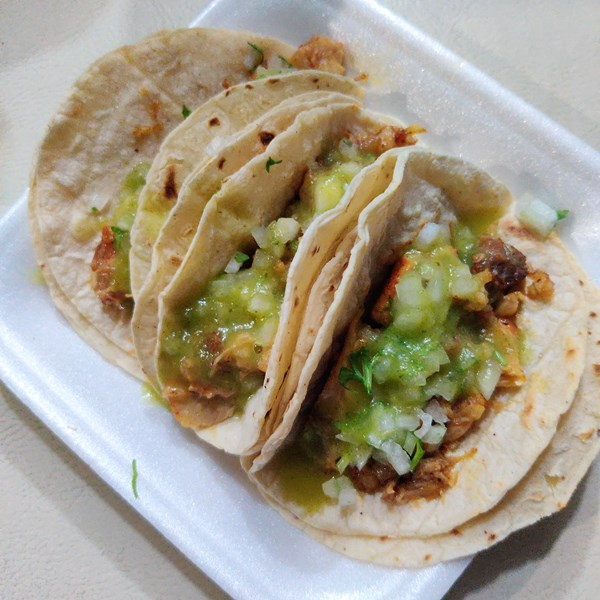 Orange Walk tacos with avocado sauce sold in San Pedro