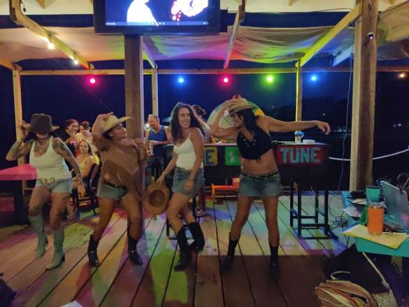 girls dancing at wayos ambergris caye