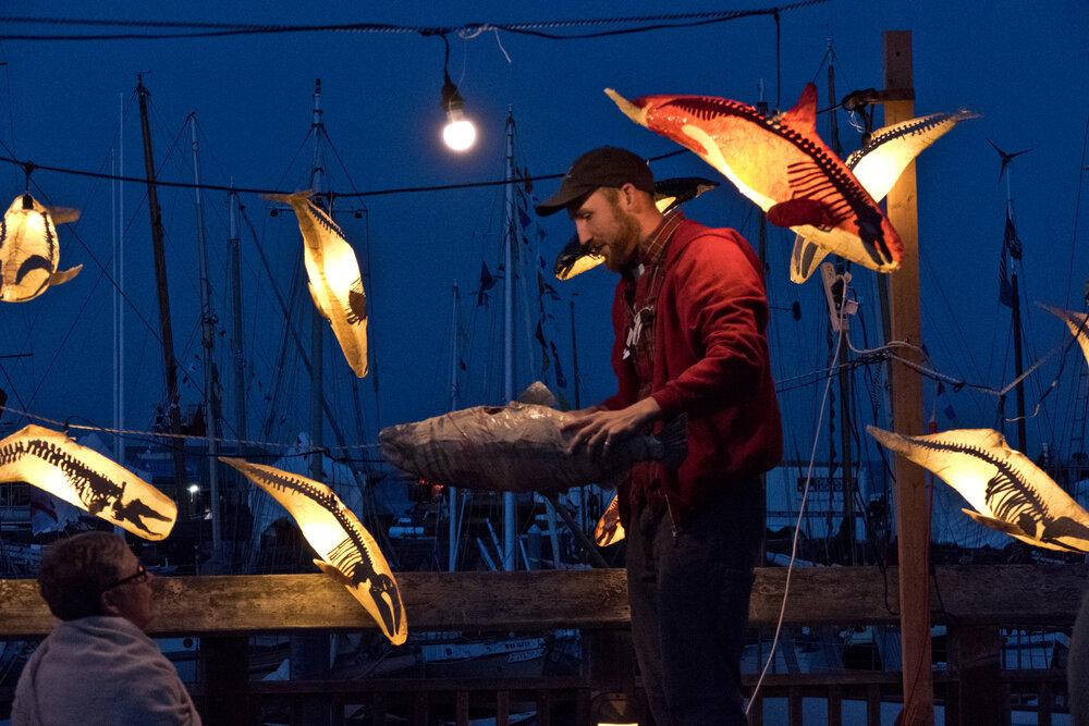 artist with whale lanterns
