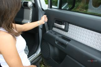 "Using a plastic tool or your finger nails you can easily ""pop"" open the power window/lock control panel."