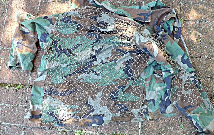 Make your own Ghillie Suit. The netting attached to a fatigue top