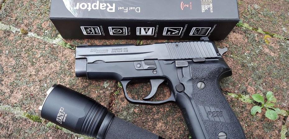 ASP Raptor tactical flashlight and Sig P228