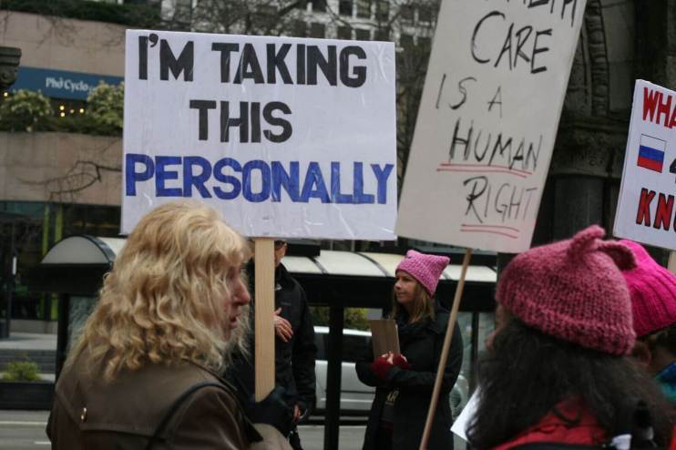 "A person holds a sign that reads ""I'm taking this personally."""