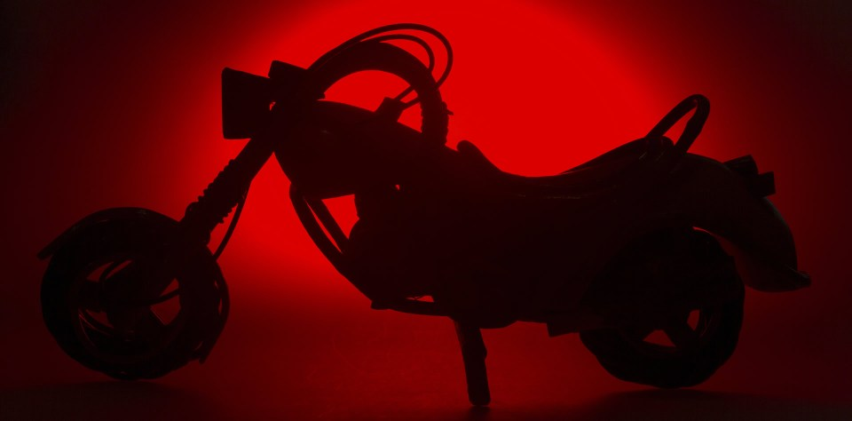 Shadow bike red background